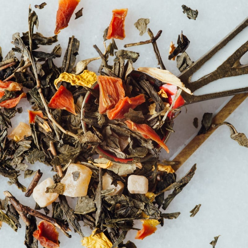 Loose leaf tea leaves with fruit pieces