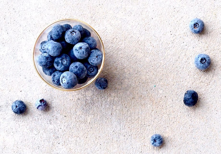 Blueberries in a glass on a white background