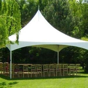 A white 6m Pagorda Marquee with chairs in a garden