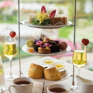 Afternoon tea with cups of tea and champagne