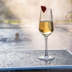 A champagne glass next to the pool