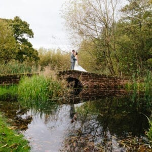 A couple stood on the bridge after getting married