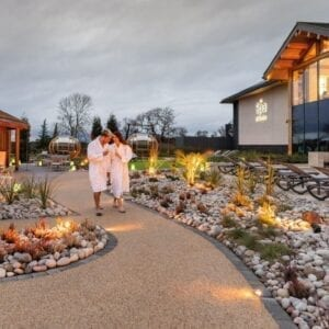 A couple walking through the outdoor part of the spa