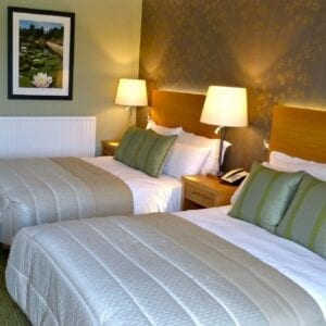 two double beds in a hotel room