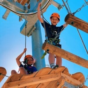 Two children on the Pursuits adventure course