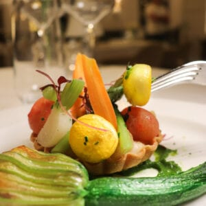 A vegetable tart on a plate at a restaurant at Carden Park