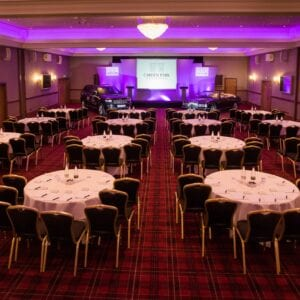 Carden Park Suite the Cabaret with tables and chairs, setup for a conference