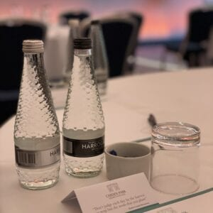 Two bottles of water on a conference room table