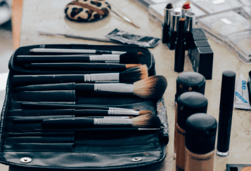 makeup and beauty brushes on a table