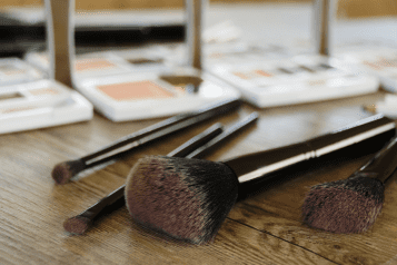 makeup brushes on a wooden table