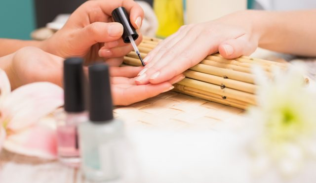 Level 2 & 3 Nail Technician Course Qualified Nail technician giving customer a manicure