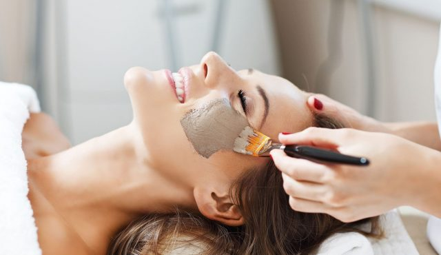 Woman with facial mask in beauty salon