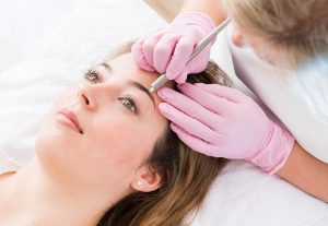 A woman having her eyebrows done