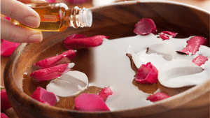 Hot oil in a bowl with flower petals